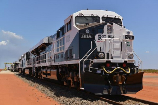R/C trains haul ore in extreme heat so humans don't have to