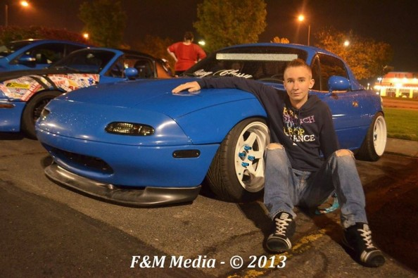 19-year-old Thomas Jost with his prized Mazda Miata