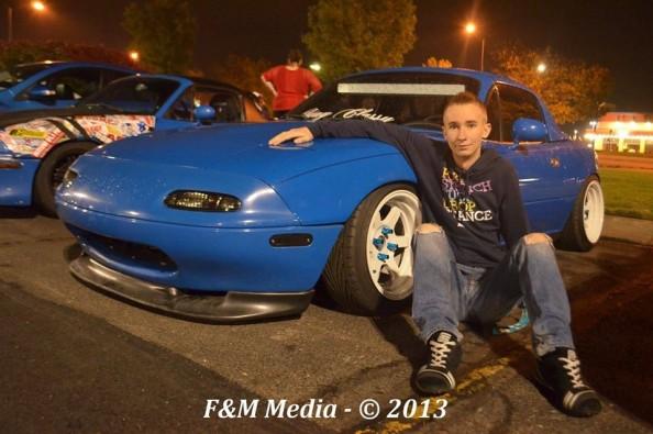 19-year-old Thomas Jost with his prized Mazda Miata