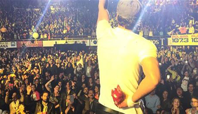 Enrique Iglesias hides his bloody hand after grabbing a drone