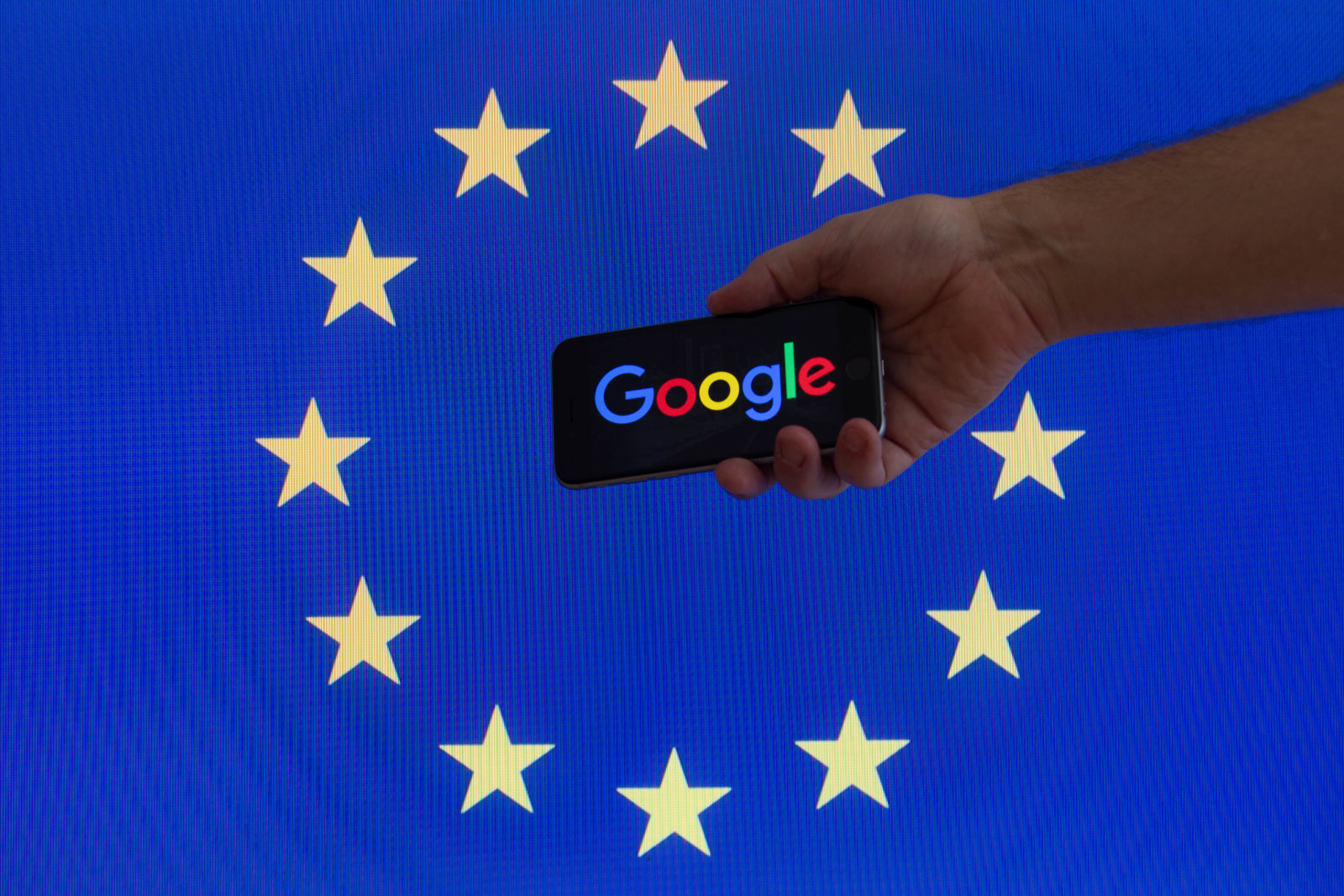 The EU flag is seen with Google logo. (Photo by Jaap Arriens/NurPhoto via Getty Images)