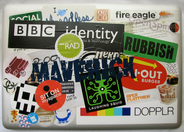 macbook covered in stickers