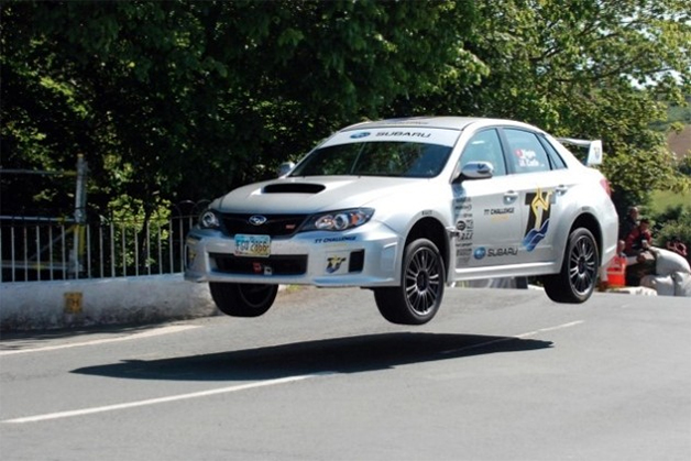 Dave Higgins sets a lap record around the Isle of Man TT course in a 2011 Subaru WRX STI sedan.