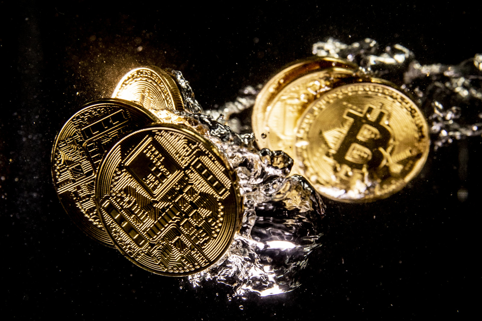 LONDON, ENGLAND - AUGUST 15: In this photo illustration a visual representation of the digital currency Bitcoin sinks into water on August 15, 2018 in London, England. Most digital currencies including Bitcoin, (BTC) Ethereum, (ETH) Ripple (XRP) and Stella (XLM) have seen a dramatic fall in their prices throughout 2018 amid a 'mass sell-off'. In December 2017 the price of BTC hit $20,000 USD but has since fallen to around $6000 USD.   (Photo Illustration by Dan Kitwood/Getty Images)