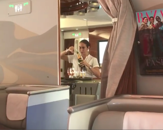 Watch an Emirates flight attendant pour Champagne dregs back into the bottle