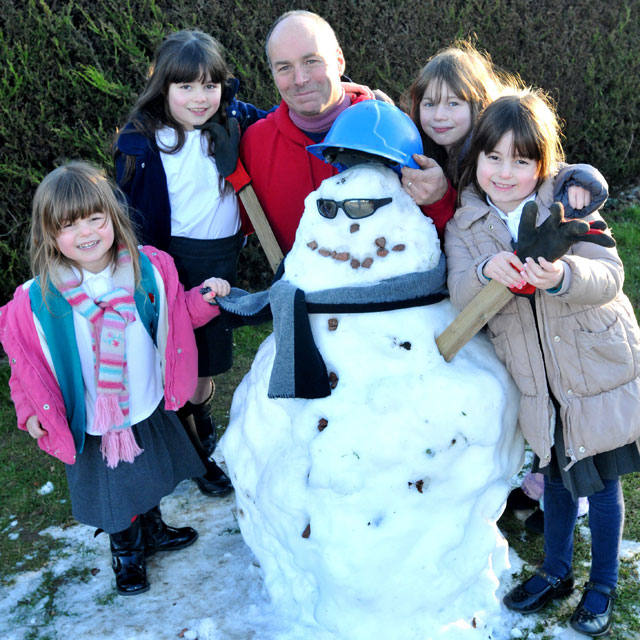 Dad-of-four drove snowman 40 miles home so daughters could keep him