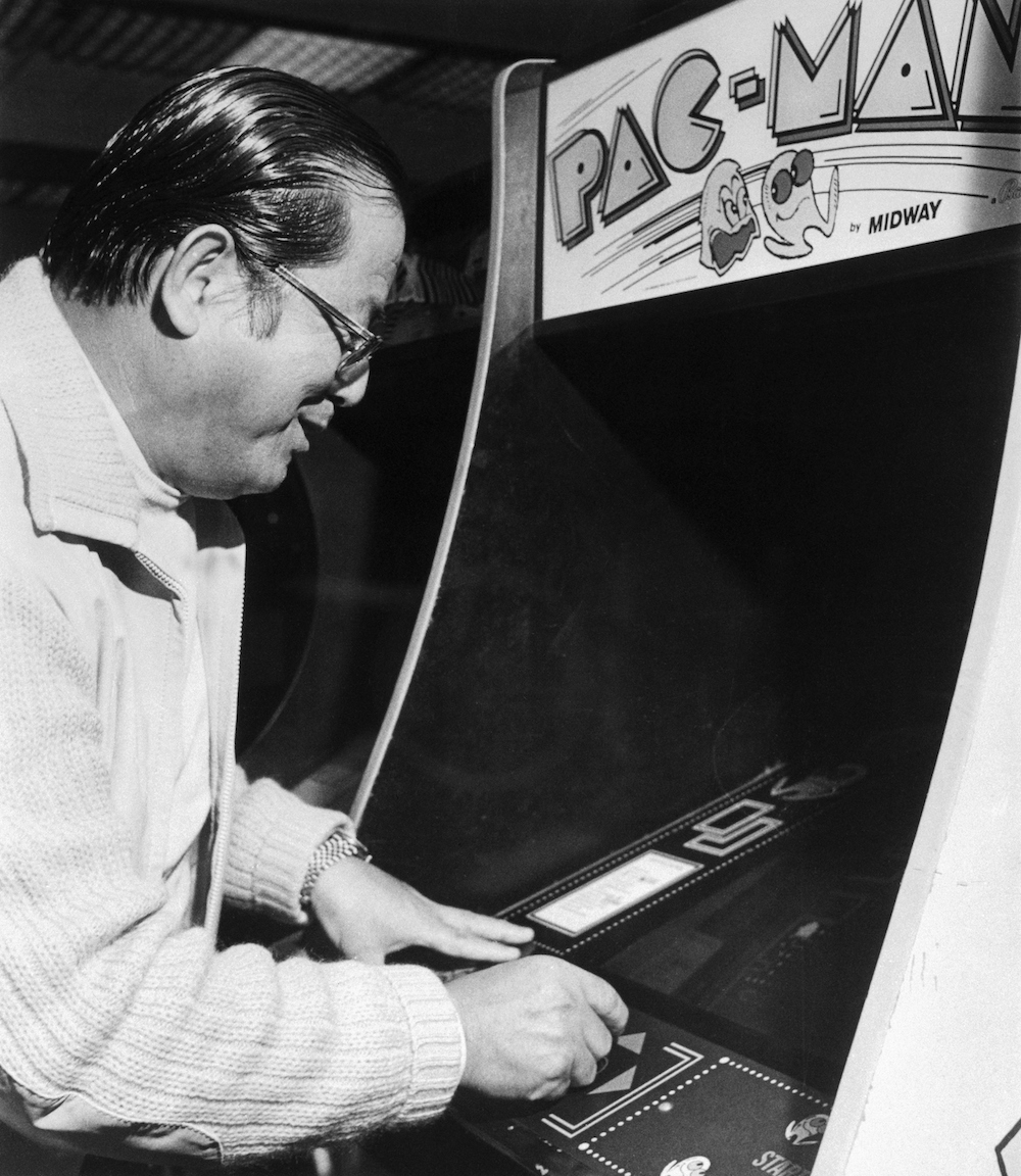 "(Original Caption) Masaya Nakamura, father of the popular video arcade game, takes a turn at Pac-Man. He's happy about the global success of his creation, but a ""little concerned about the way some young people play so much."""