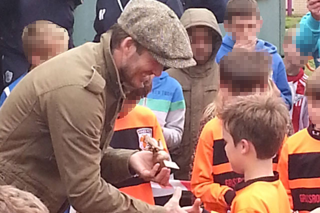 David Beckham presents cup winner's medal to nine-year-old son Cruz