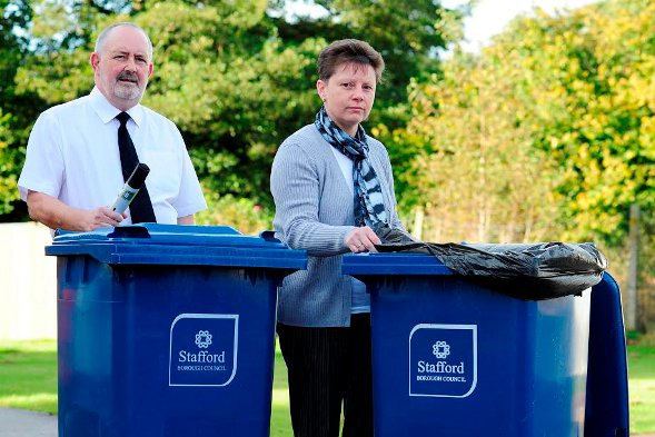 Paul and Nicola Davies with their bins.