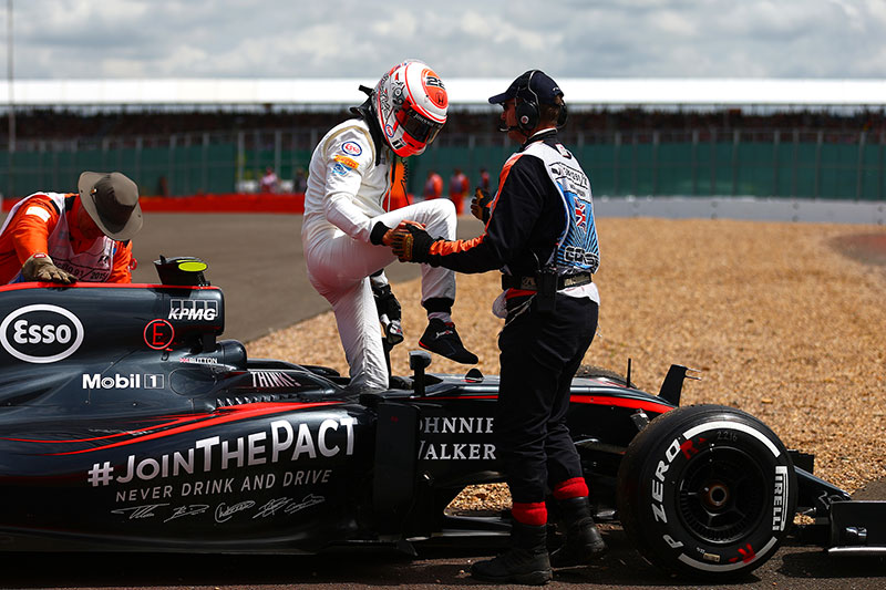 Jenson Button's race ends early at the 2015 British Grand Prix.