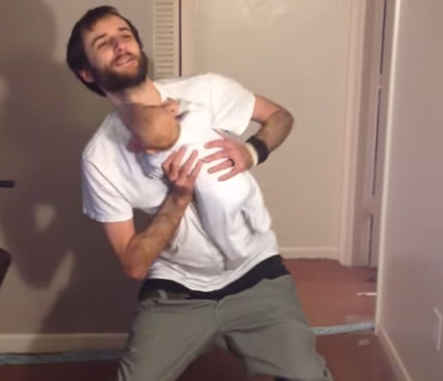 dad puts trousers on with baby video