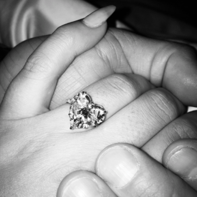 Lady Gaga is engaged to Taylor Kinney! And she has a huge heart-shaped diamond ring