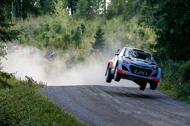 Haydon Pannon takes a jump in his Hyundai i20 WRC in the Neste Oil Rally Finland.