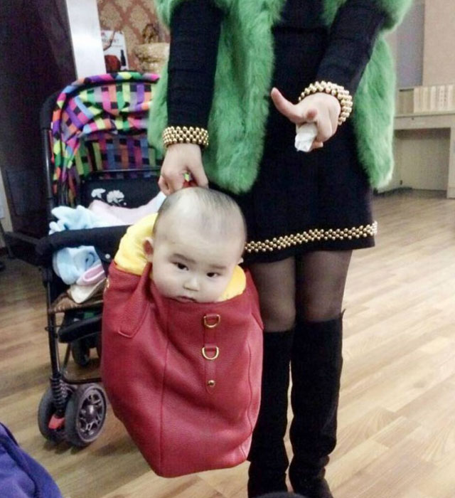 Mum criticised for putting her baby in a handbag
