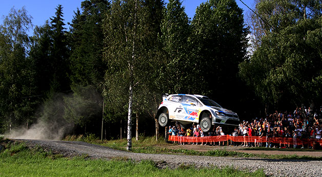 A Volkswagen Polo R WRC takes a jump in the Neste Oil Rally Finland.