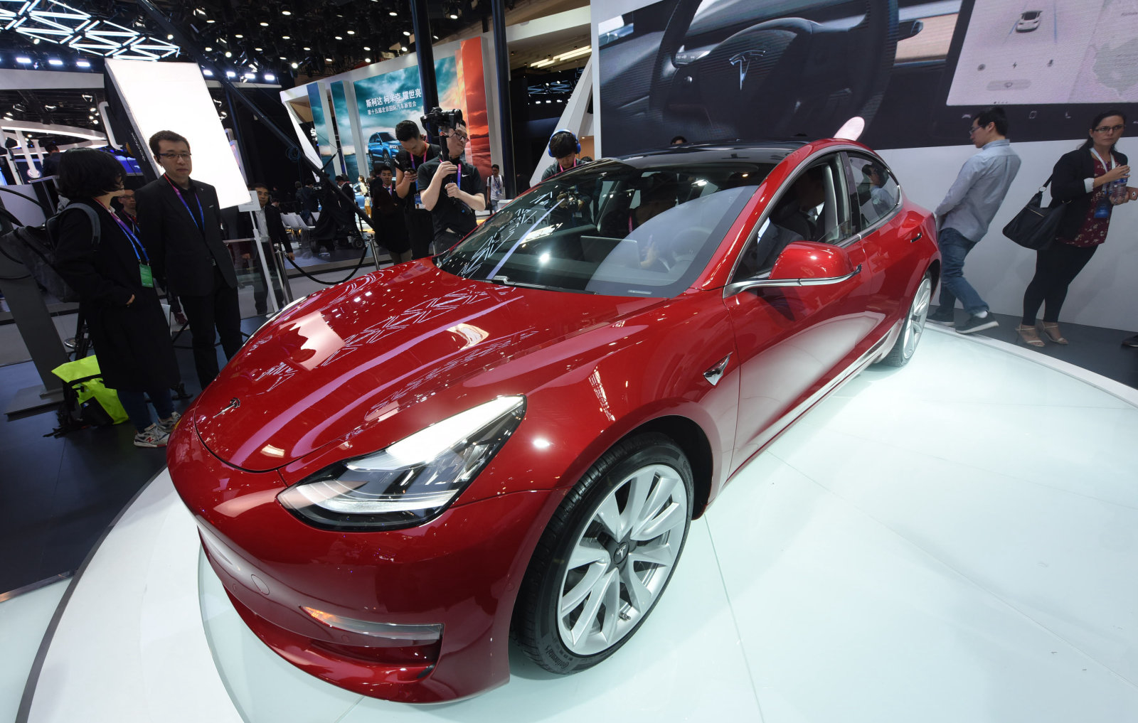 BEIJING, CHINA - APRIL 25:  A Tesla Model 3 car is on display during the Auto China 2018 at China International Exhibition Center on April 25, 2018 in Beijing, China. Auto China 2018, also known as 2018 Beijing International Automotive Exhibition, will be held from April 27 to May 4.  (Photo by VCG/VCG via Getty Images)