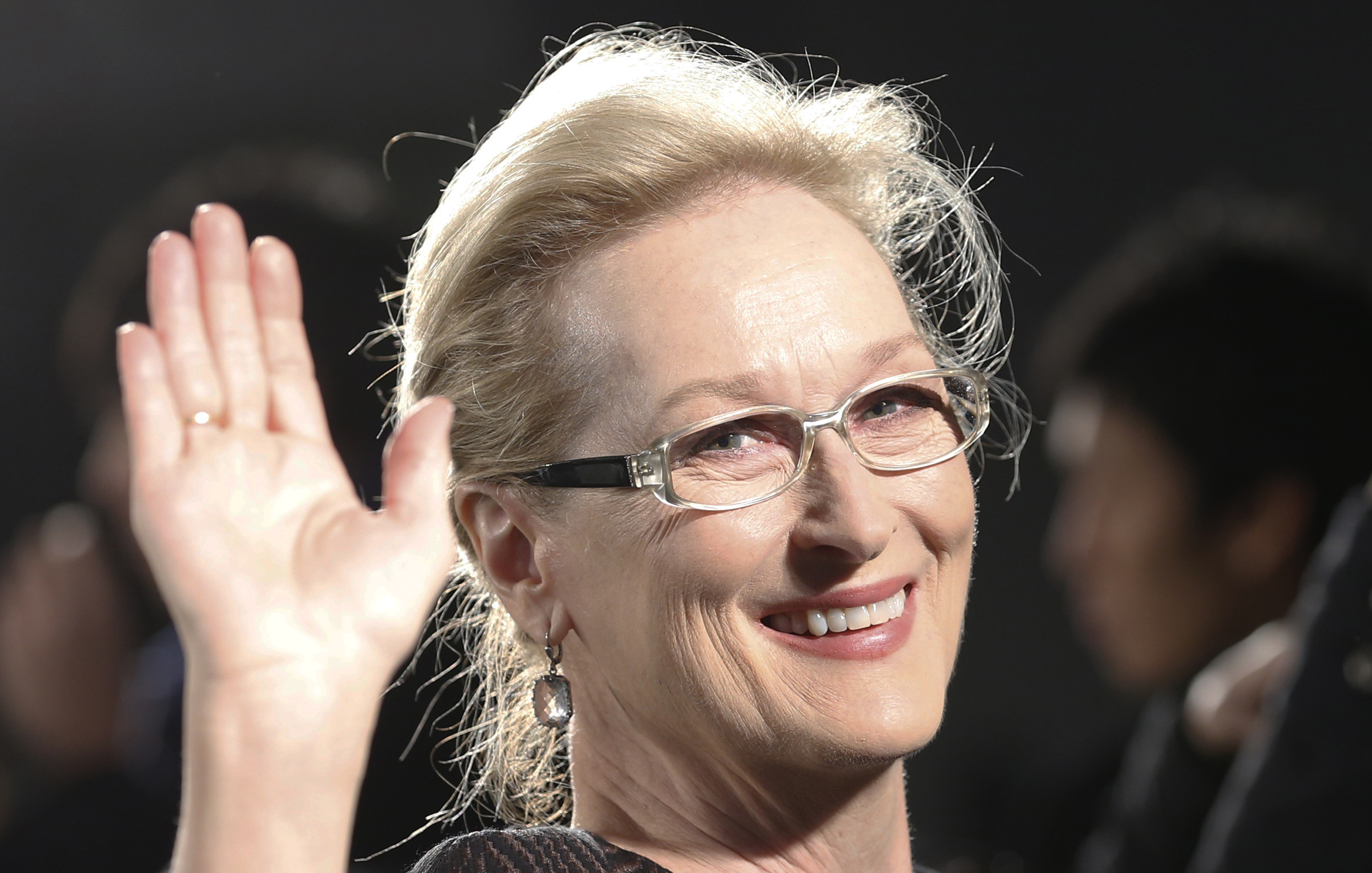 "Meryl Streep waves for photographers during the Japan premiere of ""Into the Woods"" in Tokyo Wednesday, March 4, 2015. (AP Photo/Shizuo Kambayashi)"