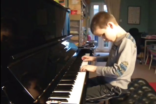 Blind boy, 10, scoops prestigious prizes for piano playing