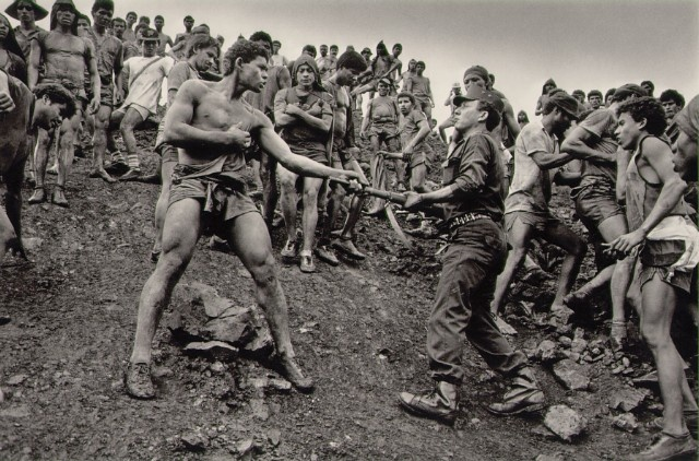 manliest photos on the internet, funny manly images, brazilian miner grabs guard's gun