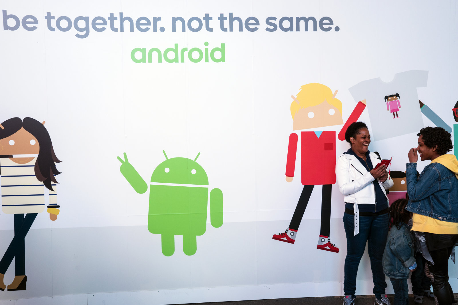 Google's biggest ad blitz for Android took place in Times Square. Google gave away t-shirts and postcards for free to thousands of users. Using Google's Androidify app on iOS and Android smartphones and tablets, users created their own Android characters that were printed on t-shirts and postcards. Google employees helped users and printed the cards and t-shirts to give away, on site. (Photo by ANDREW HOLBROOKE/Corbis via Getty Images)