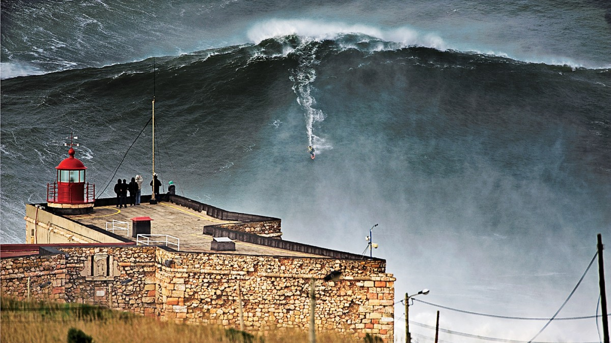 manliest photos on the internet, funny manly images, garrett mcnamara 100-foot wave portugal