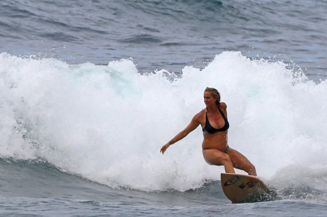 One-armed shark attack survivor carries on surfing at six months pregnant