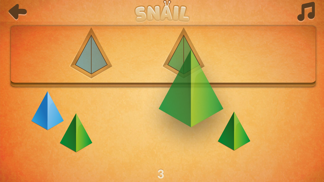 Young children match colored shapes with the correct slot in Snail game