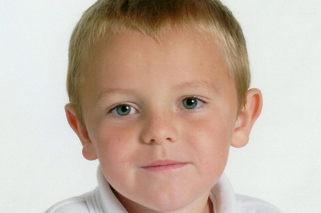 Boy, 10, killed by teacher's car outside school as he chatted on mobile phone