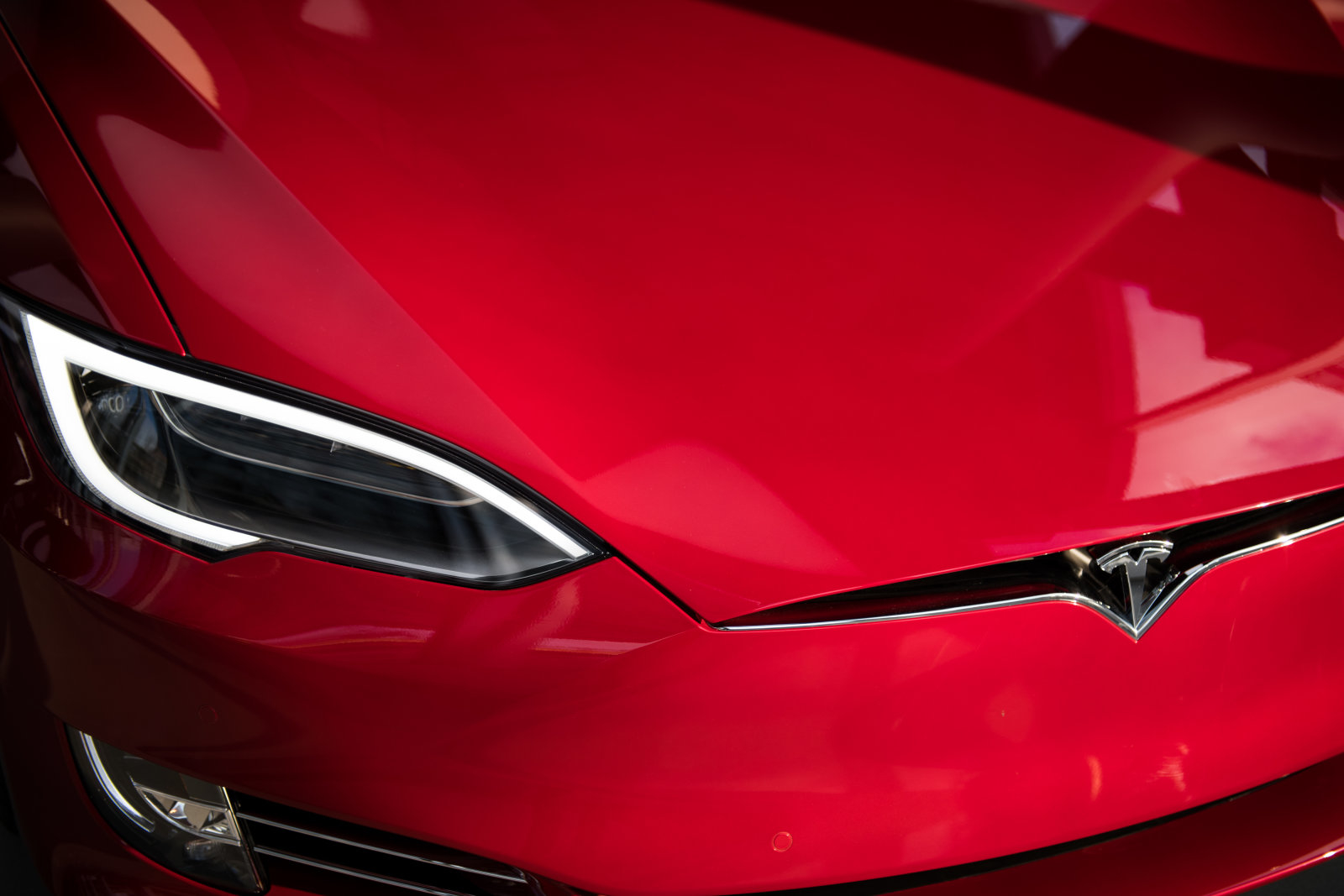 FILE: The headlight of a Tesla Inc. Model S P100D sedan vehicle is seen at the company's new showroom in New York, U.S., on Thursday, Dec. 14, 2017. For BMW AG, Tesla Inc. and other global automakers whose future is ever-more dependent on Chinas burgeoning market, any gains from lower import tariffs this week will likely be short-lived -- thanks to President Donald Trumps trade war. Unless President Trump backs down, on July 6 the U.S. will impose tariffs on $34 billion of Chinese imports, many of them parts used in products such as marine engines and power turbines. China will impose countervailing levies the same day -- including on U.S.-manufactured cars. Our editors select archive images of the leading brands affected by the trade war. Photographer: Mark Kauzlarich/Bloomberg via Getty Images