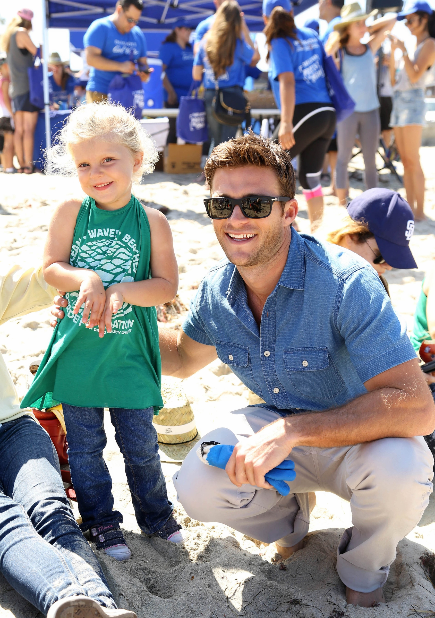 New York City -  July 10, 2016:  Looking good while doing good, Scott Eastwood, the face of Davidoff Cool Water, supports the brand's #LoveTheOcean campaign at a beach cleaunp in Ocean Beach.  -  PICTURED: Scott Eastwood with fan - PHOTO BY: Sara Jaye Weiss/StartraksPhoto.com