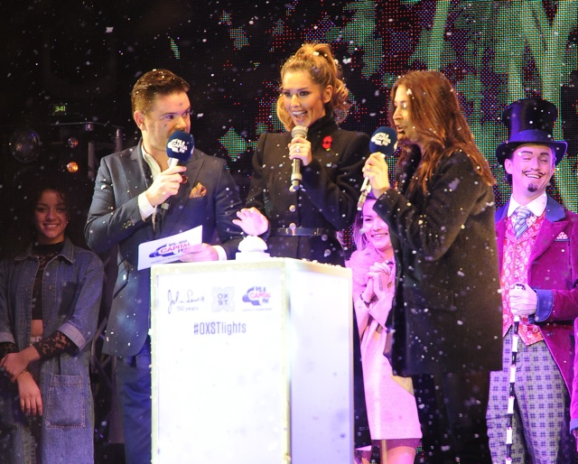 Cheryl Fernandez-Versini switches on Oxford Street Christmas lights in Alexander McQueen coat