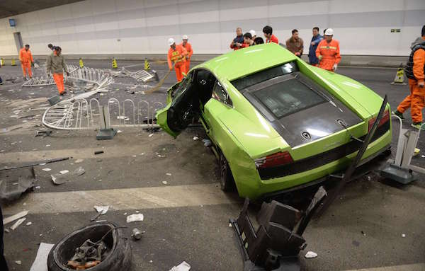 "This photo taken early on April 12, 2015 shows a badly damaged Lamborghini car and debris in a tunnel after a crash involving a Ferrari in Beijing. The two cars crashed late on April 11 in a high-speed road race in Beijing as the seventh stunt-filled ""Fast and the Furious"" movie opened in China, the latest luxury car accident to provoke controversy on April 13.       CHINA OUT   AFP PHOTO"