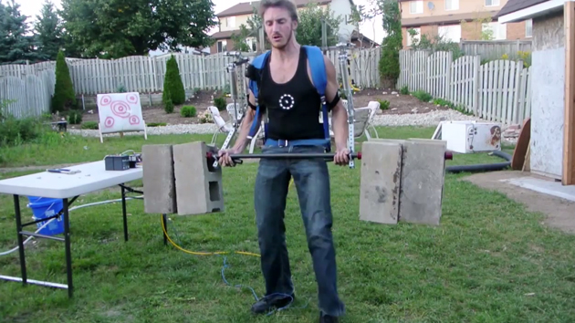 James Hobson lifts cinder blocks with his exoskeleton