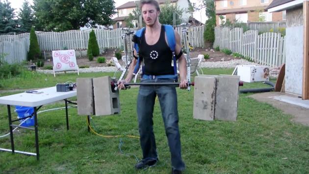 Homemade exoskeleton lets a man lift big cinder blocks with ease