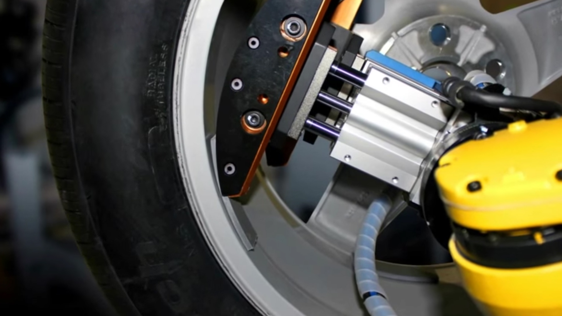 This new machine mounts wheel weights in seconds