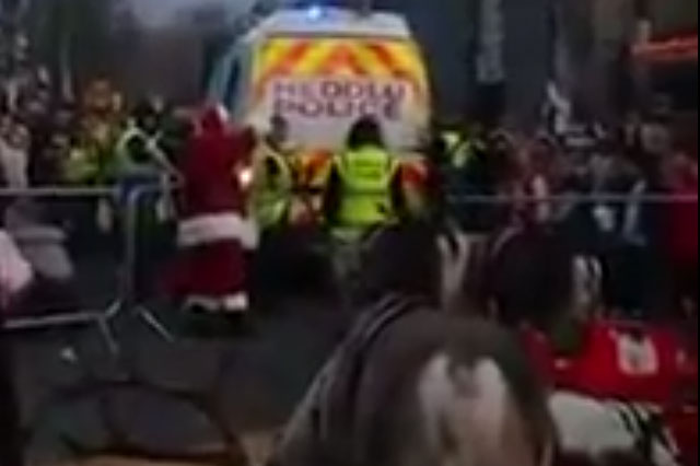 Father Christmas leaves kids distraught as he is taken away in police van