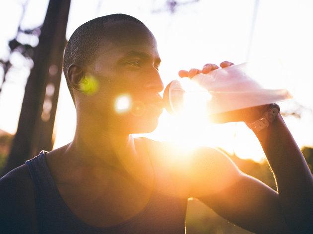 man-using-reuseable-water-bottle