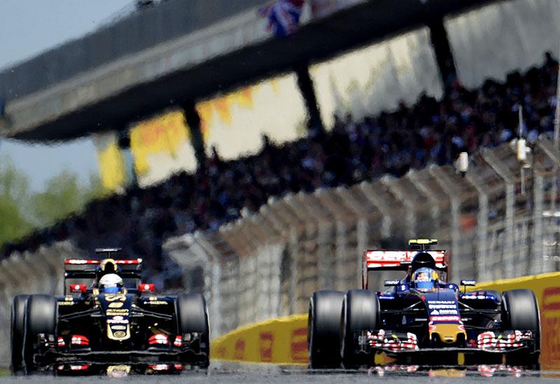 Carlos Sainz leads Romain Grosjean at the 2015 Spanish Formula One Grand Prix.
