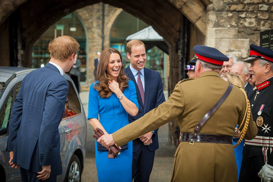 Duchess Kate in royal blue amid a sea of red poppies