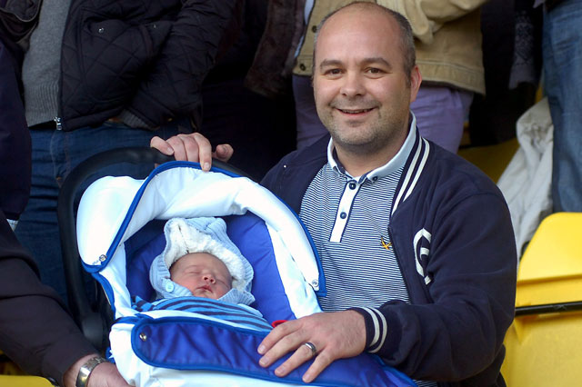 Footy mad dad takes newborn son to football match
