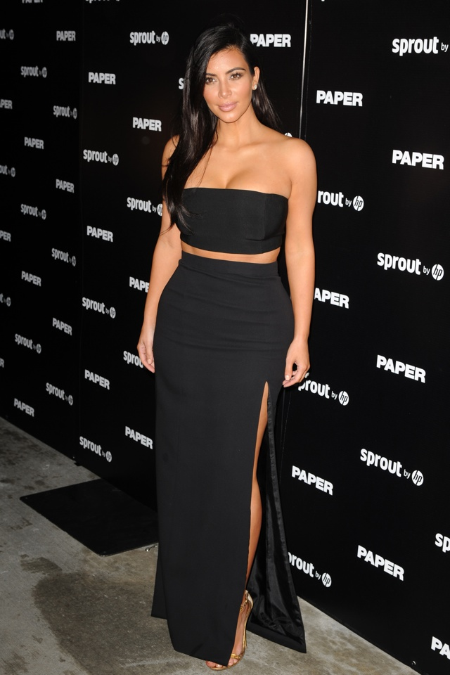 Kim Kardashian works crop top for launch of nude Paper magazine issue