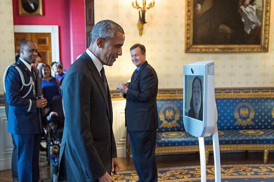 President Obama greets Alice Wong via robot
