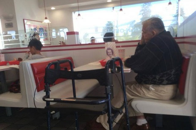Photos of elderly man dining alone with picture of his late wife go viral