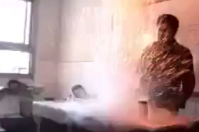 Bungling chemistry teacher's explosive experiment terrifies pupils (video)