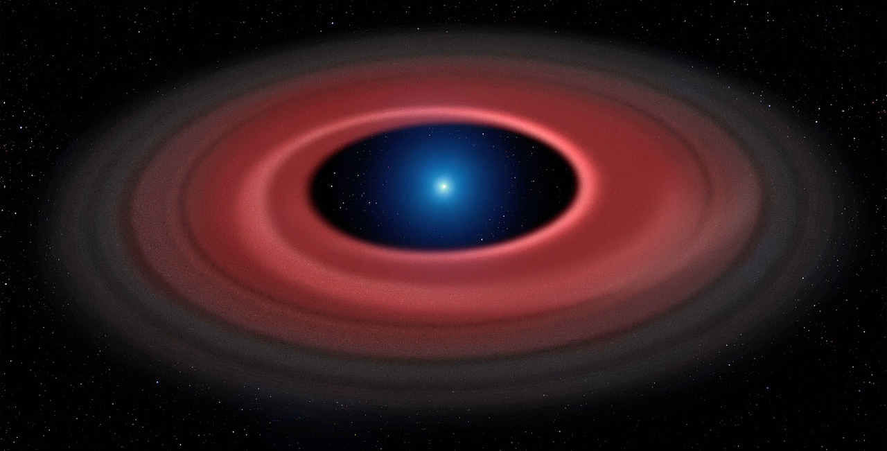 This artist's impression shows how an asteroid torn apart by the strong gravity of a white dwarf has formed a ring of dust particles and debris orbiting the Earth-sized burnt out stellar core SDSS J1228+1040. Gas produced by collisions within the disc is detected in observations obtained over twelve years with ESO's Very Large Telescope, and reveal a narrow glowing arc.