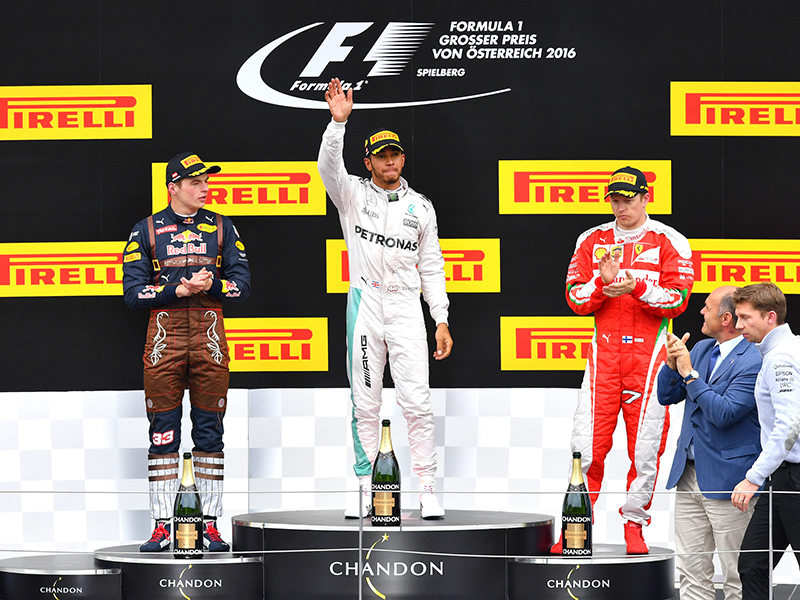 Red Bull driver Max Verstappen, left, Mercedes driver, winner Lewis Hamilton, center, and Ferrari driver Kimi Raikkonen, of Finland, celebrate after the Formula One Grand Prix, at the Red Bull Ring racetrack in Spielberg, southern Austria, Sunday, July 3, 2016. Lewis Hamilton pushed past Mercedes teammate Nico Rosberg on the final lap to win the Austrian Grand Prix on Sunday. Max Verstappen in a Red Bull was second and Kimi Raikkonen of Ferrari was third.