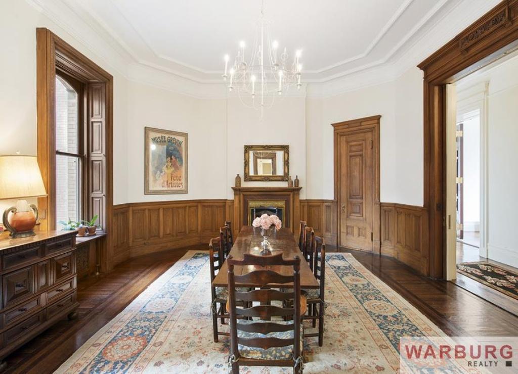 Original mahogany woodwork graces the grand and elegant dining room.
