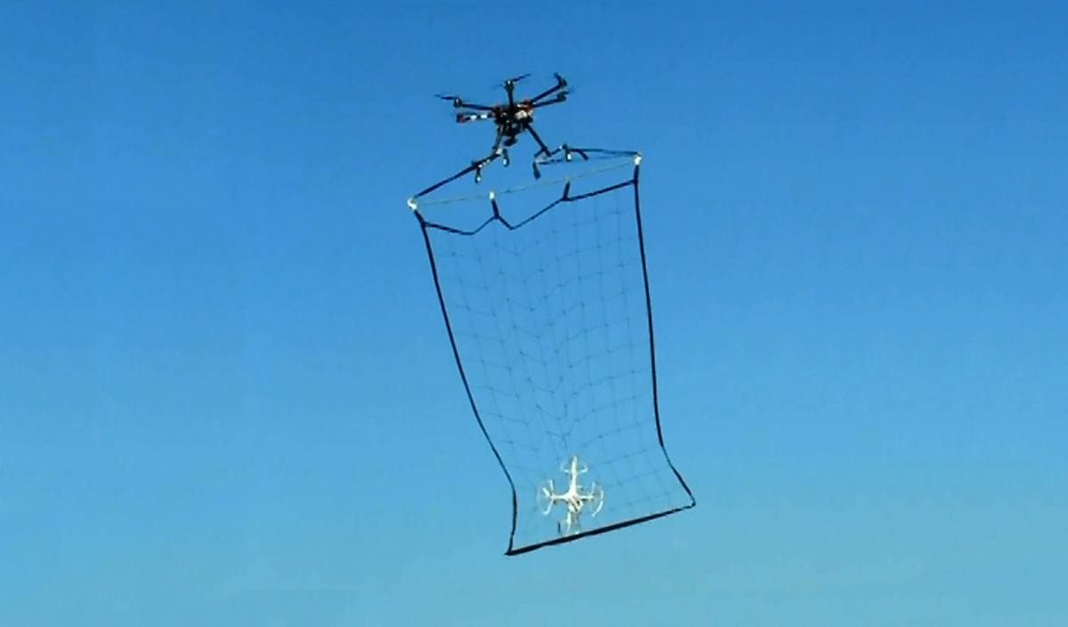 picture of drone hunting down a drone with net