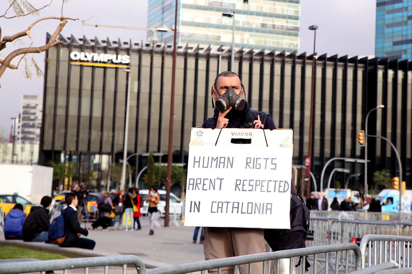 A Catalan man protests against the dangers of electronic pollution outside Mobile World Congress in Barcelona.