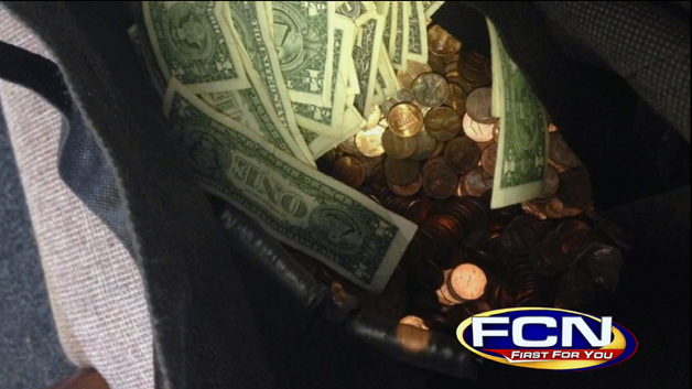 Woman refunded by dealer with bag of pennies